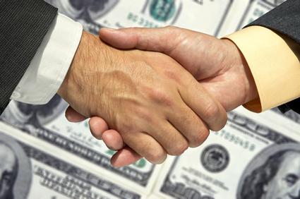 handshake  behind a money(US dollar) background.Great for any design.